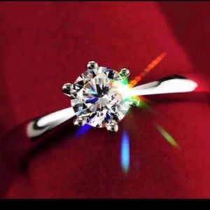 New 18 k white gold engagement ring